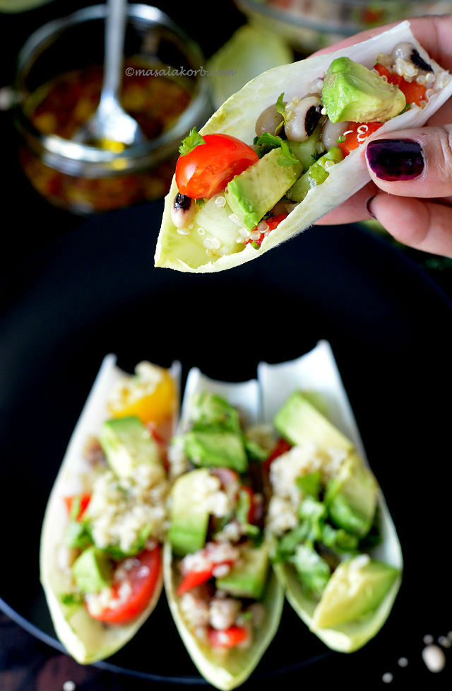 black eyed pea quinoa salad in endive boats  masalakorb